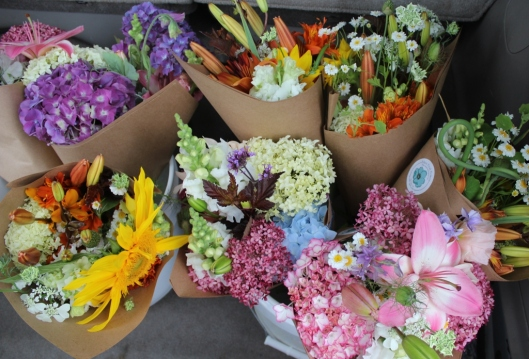 Kathleen delivers buckets of bouquets to Astoria Co-op Grocery once or twice each week.