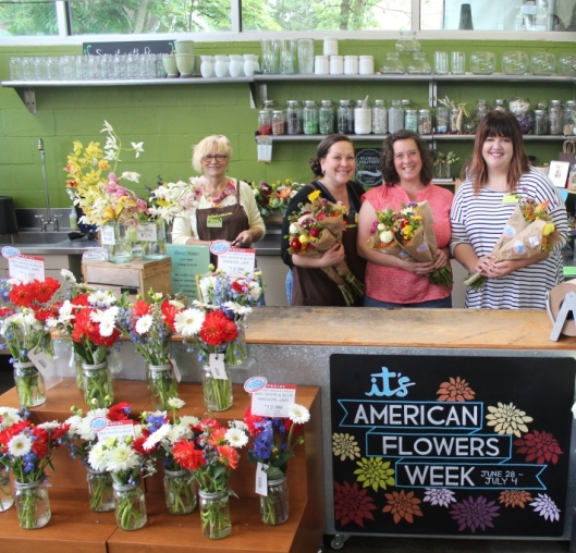 New Seasons' floral manager Katie McConahay (right) with flower farmre Bethany Little (second from right) and team members Alaina and Guen (manager) at the Arbor Lodge neighborhood store in Portland.