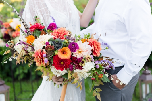 Fall-blooming celosia and late-season dahlias are the focal elements of the bridal bouquet.